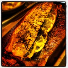 """Place cedar plank and salmon on the grill once its reached at least 500 degrees. Then step away and let the grill work its magic. Peek on it after about 15 - 20 minutes, Determine by touch or temp for desired """"doneness"""". Once you reached the proper temp for you, Remove from grill, loosely tent with foil and let rest for 5=7 minutes."""