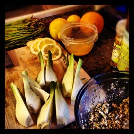 Quarter the fennel bulbs, Squeeze juice of 1 lemon and 1 orange in to a small mixing bowl. Add to Pesto and toss the fennel bulbs with mixture. In a dutch oven bring 2 tbsp of olive to medium high heat, place the bulbs in flat side down in the oil. Sear bulbs just until slightly browned. Remove bulbs. Add chopped garlic to the oil and brown, add the wine to de-glaze. Return bulbs to dutch oven add vegetable broth just until the bulbs are submerge about half. Place in a 350 degree oven for 20 - 25 minutes.