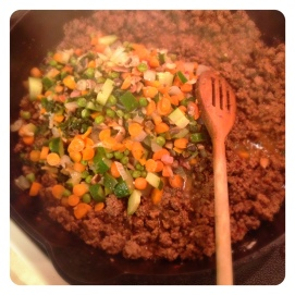 Add veggies to browned ground beef